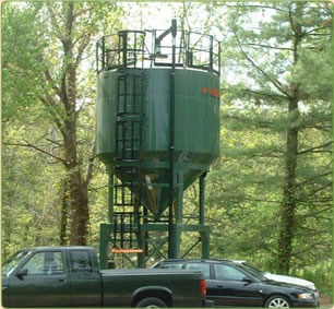 Giant green soil silo